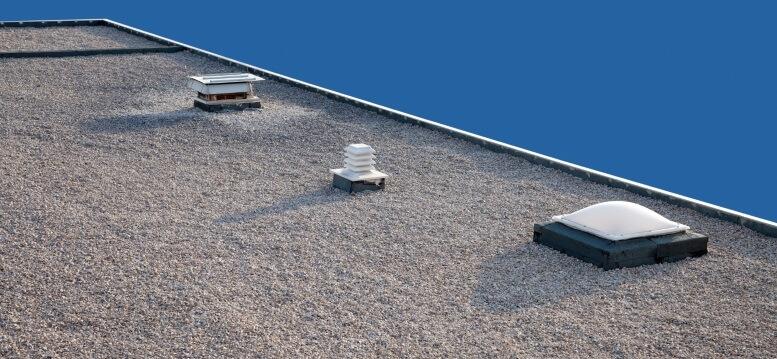 plat dak met lichtkoepel